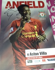Signed Liverpool programme by Gerrard Toure and Sturridge